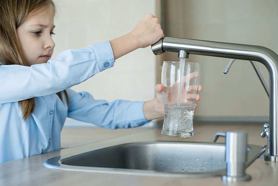 Child Pouring Glass Of Clean Water